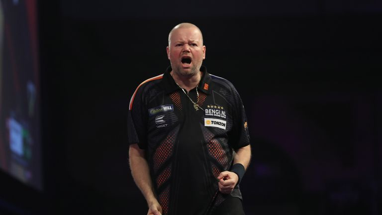 A relaxed and confident Raymond van Barneveld cruised into round two