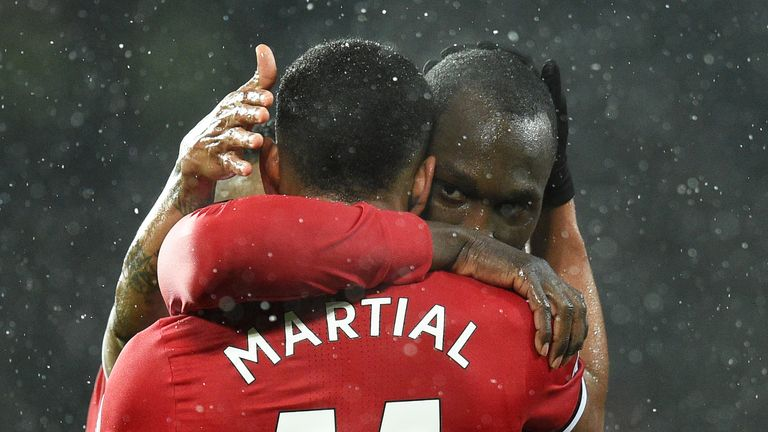 Romelu Lukaku celebrates with Anthony Martial
