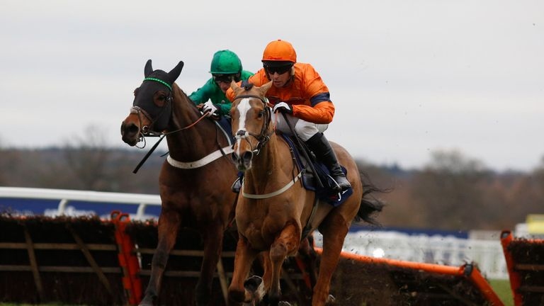Sam Spinner ridden by Joe Colliver lead L'Ami Serge and Daryl Jacob over the last flight before going on to win The JLT Reve De Sivola Long Walk Hurdle Rac