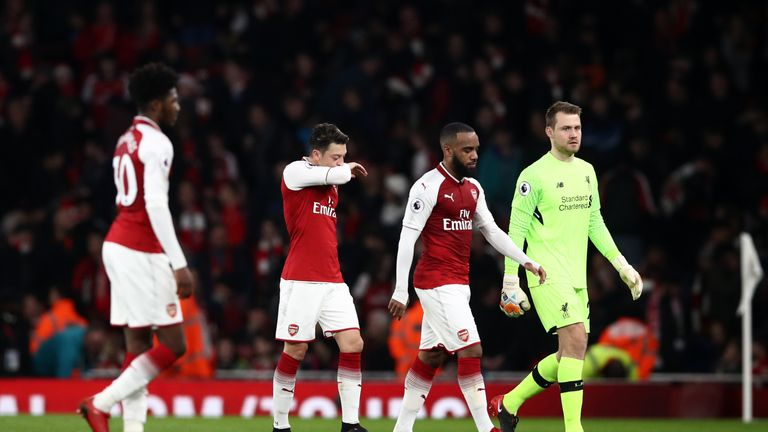Arsenal's Mesut Ozil (centre left) walks off dejected at half time during the Premier League match at the Emirates Stadium, London