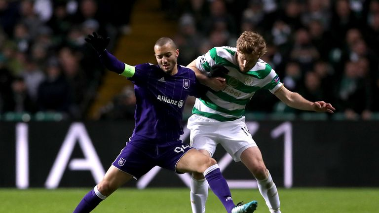 GLASGOW, SCOTLAND - DECEMBER 05:  Sofiane Hanni of RSC Anderlecht is challenged by Stuart Armstrong of Celtic during the UEFA Champions League group B matc