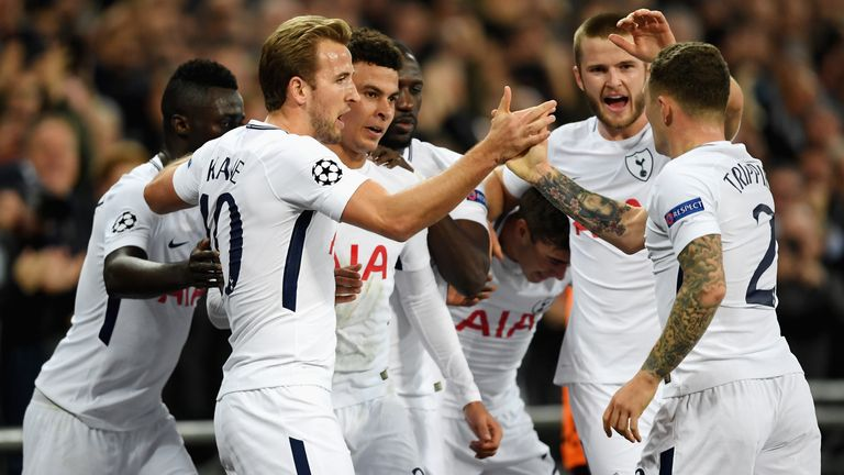 Dele Alli of Tottenham Hotspur celebrates scoring his side's first goal with team mates during the Champions League