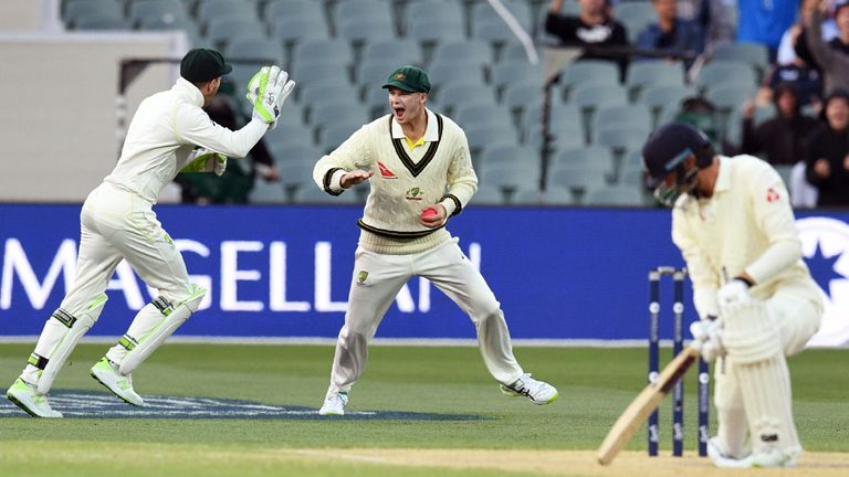 Australia's Peter Handscomb celebrates with Tim Paine after taking a catch to dismiss Vince in the Ashes
