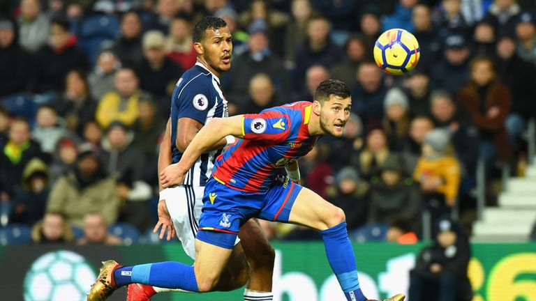 Crystal Palace defender Joel Ward (right) wins a header under pressure from West Brom striker Salomon Rondon