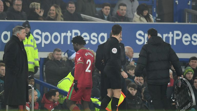 LIVERPOOL, ENGLAND - DECEMBER 18:  An injured Wilfried Bony of Swansea City (2) is substituted during the Premier League match between Everton and Swansea