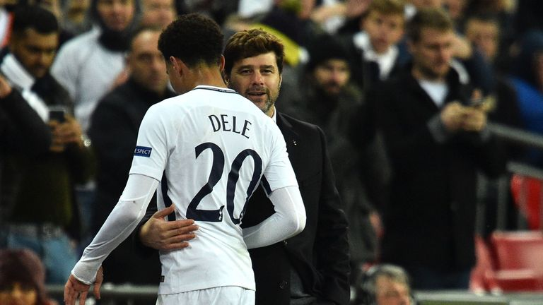 Tottenham Hotspur midfielder Dele Alli is embraced by head coach Mauricio Pochettino as he leaves the pitch in the win over Apoel in December 2017