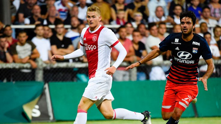 Ajax defender Matthijs de Ligt vies with Lyon's French midfielder Clement Grenier during a friendly football match against Lyon