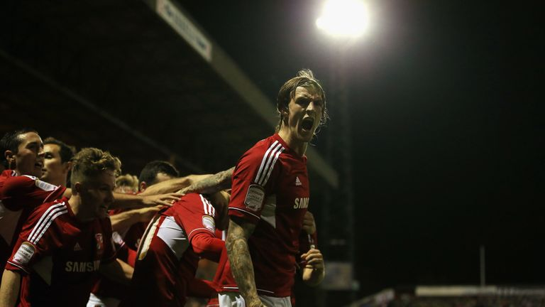 Aden Flint of Swindon Town celebrates the equalising goal scored by Miles Storey during the Capital One Cup Fourth Round match against Aston Villa in 2012