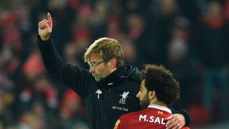Mohamed Salah (R) goes off and embraces Liverpool manager Jurgen Klopp (L) as he passes during the Premier League match v Manchester City