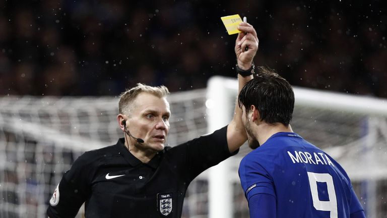 Chelsea's Spanish striker Alvaro Morata (R) gestures to referee Graham Scott (L) as he gets a yellow card during the FA Cup third round replay football mat