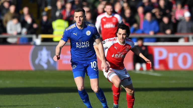 Andy King of Leicester City and Markus Schwabl of Fleetwood Town in action during The Emirates FA Cup