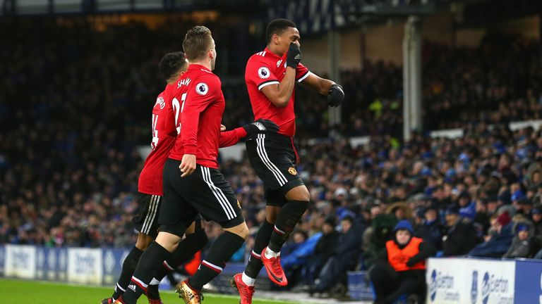 Anthony Martial of Manchester United celebrates with team mates after scoring his sides first goal during the Premier Lea