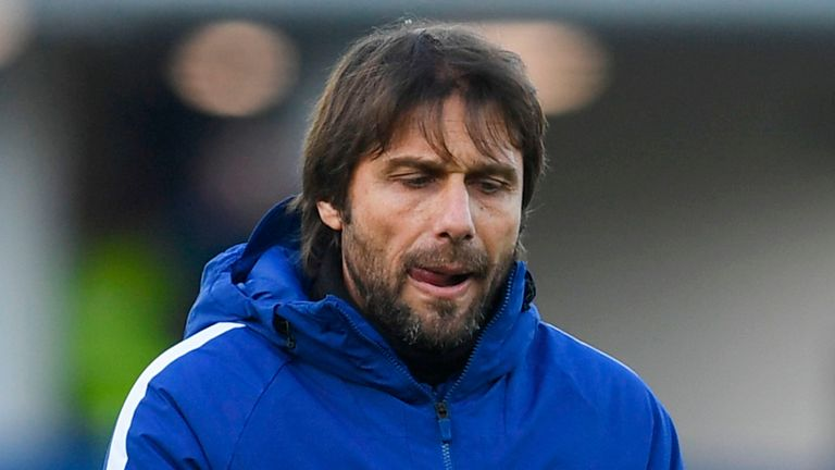 Chelsea's Italian head coach Antonio Conte gestures on the pitch after the English Premier League football match between Everton and Chelsea at Goodison Pa