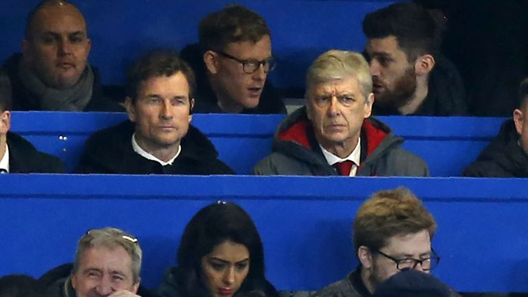 Arsenal's French manager Arsene Wenger (centre right) sits beside Arsenal's former goalkeeper Jens Lehmann in the press box during the English League Cup s