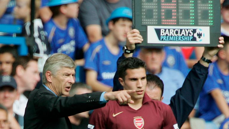Arsenal Manager, Arsene Wenger has talks with Robin Van Persie during the