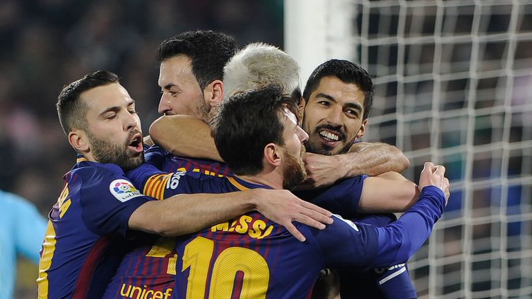 Barcelona's players celebrate during their 5-0 win over Betis