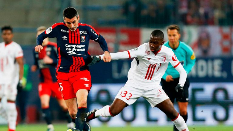 Caen's French midfielder Julien Feret (L) vies for the ball with Lille's Boubakary Soumare (R) during the French L1 football match between Caen (SMC) and L
