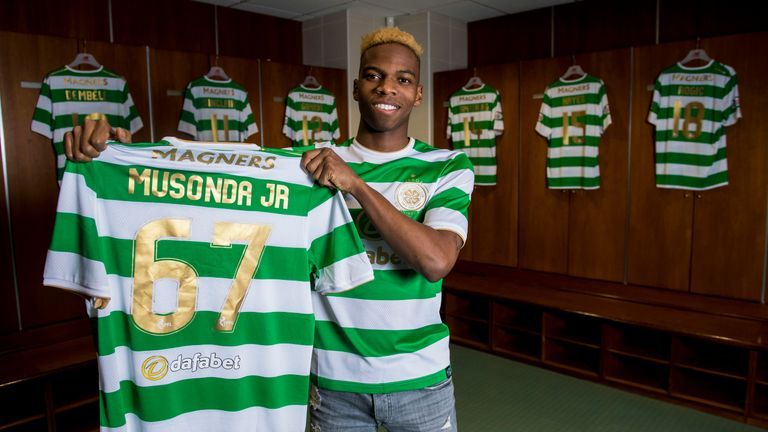 New signing Charly Musonda poses with a club shirt at Celtic Park
