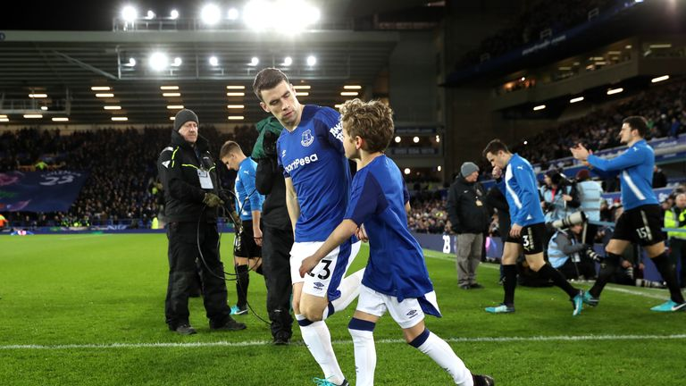 LIVERPOOL, ENGLAND - JANUARY 31:  Seamus Coleman of Everton walks out with a mascot prior to the Premier League match between Everton and Leicester City at
