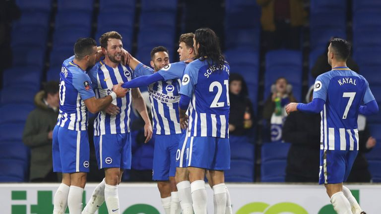 BRIGHTON, ENGLAND - JANUARY 08:  Dale Stephens of Brighton and Hove Albion (2L) celebrates as he scores their first goal with team mates during The Emirate
