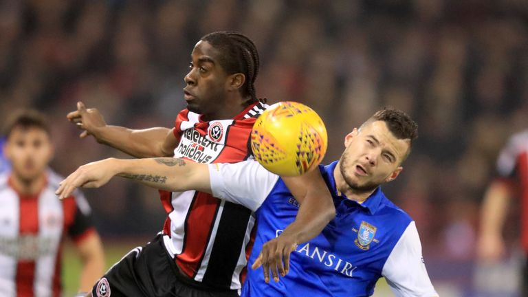 Sheffield Wednesday's Daniel Pudil (right) and Sheffield United's Clayton Donaldson battle for the ball during the Sky Bet Championship match at Bramall La