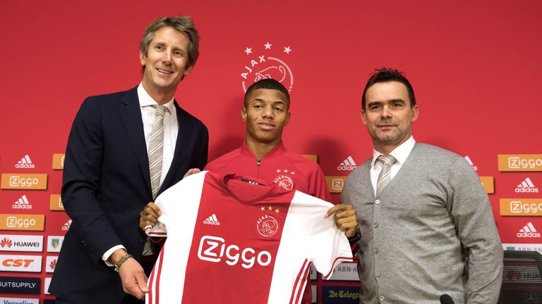 David Neres poses with Ajax Amsterdam football club's marketing directors Edwin van der Sar (L) and Marc Overmars (R)