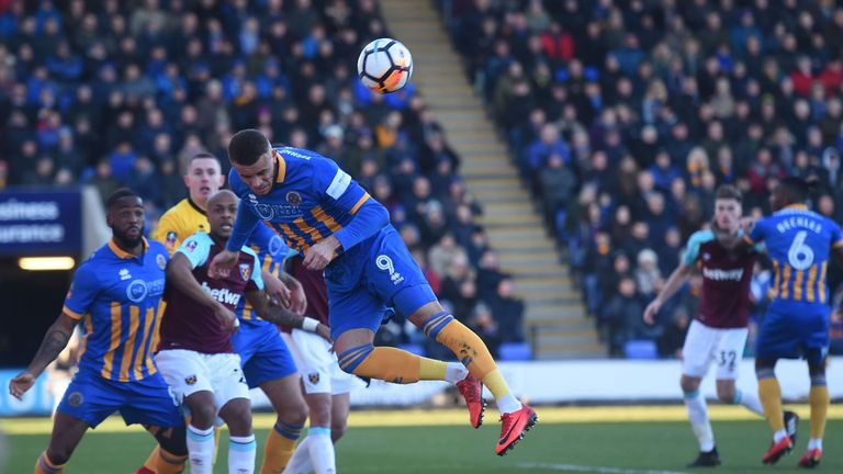 Shrewsbury Town's Carlton Morris (C) defends from a corner during the English FA Cup third round match v West Ham