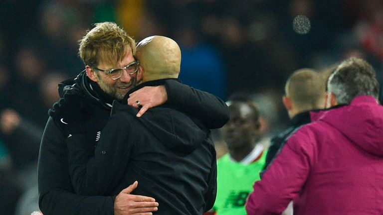 Liverpool's German manager Jurgen Klopp (L) embraces Manchester City's Spanish manager Pep Guardiola (R) at the end of the English Premier League football