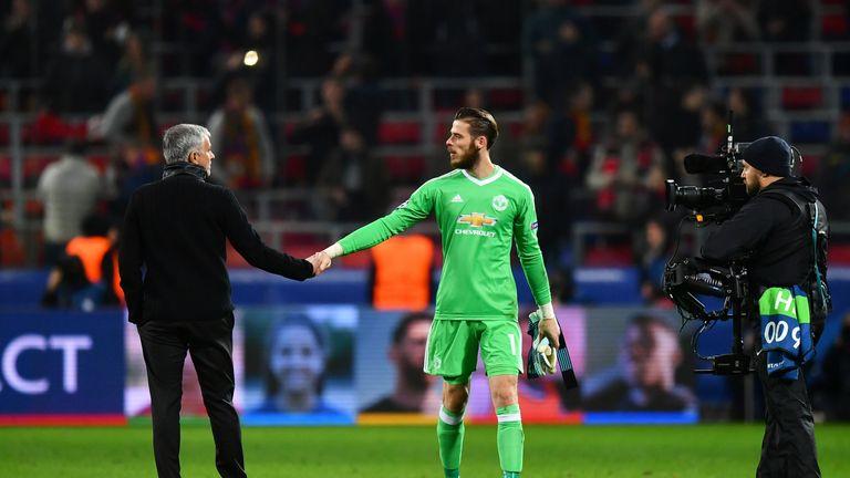 Jose Mourinho shakes hands with David De Gea