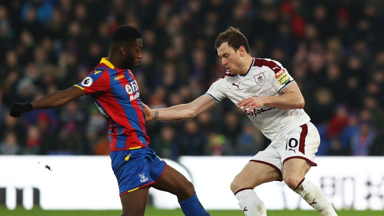 LONDON, ENGLAND - JANUARY 13: Timothy Fosu-Mensah of Crystal Paalce tackles Ashley Barnes of Burnley during the Premier League match between Crystal Palace