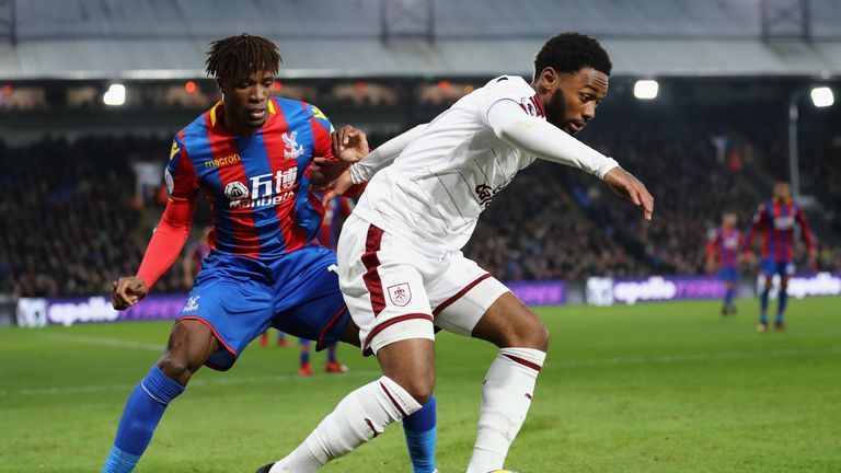 Georges-Kevin N'Koudou of Burnley is challenged by Wilfried Zaha of Crystal Palace