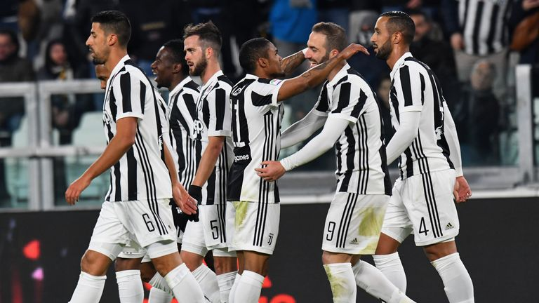 Douglas Costa scored the only goal against Genoa as Juventus moved a point behind Serie A leaders Napoli
