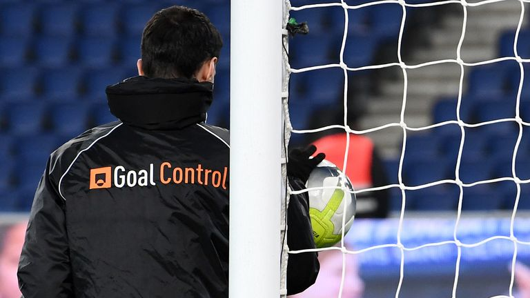 A man from the German company GoalControl checks the operation of the goal-line technology before the French L1 football match between Paris Saint-Germain