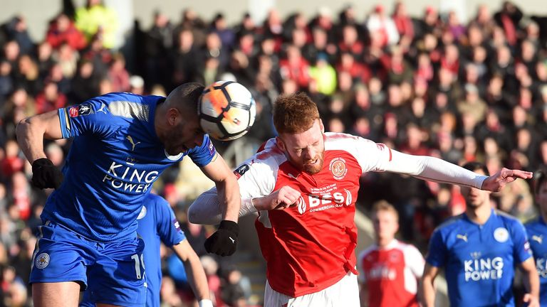 Leicester City's Algerian striker Islam Slimani (L) defends a corner from Fleetwood Town's Irish defender Cian Bolger during the English FA Cup third round