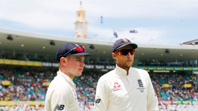 England's Joe Root talks with Mason Crane on day two of the fifth Ashes Test match at Sydney Cricket Ground