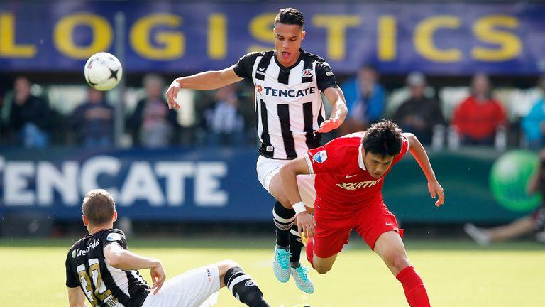 Ryo Miyaichi of Twente in action against Joey Pelupessy