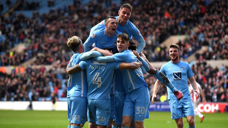 Jordan Willis  celebrates with team-mates after scoring for Coventry against Stoke