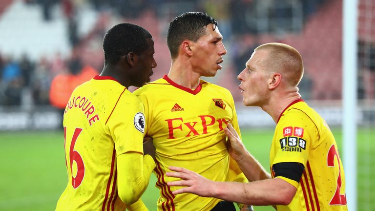 Jose Holebas of Watford is restrained by team-mates at the end of the match after arguing with his side's supporters
