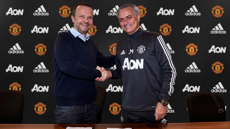 MANCHESTER, ENGLAND - JANUARY 25:  (EXCLUSIVE COVERAGE) Manager Jose Mourinho (R) of Manchester United shakes hands with Executive Vice-Chairman Ed Woodwar
