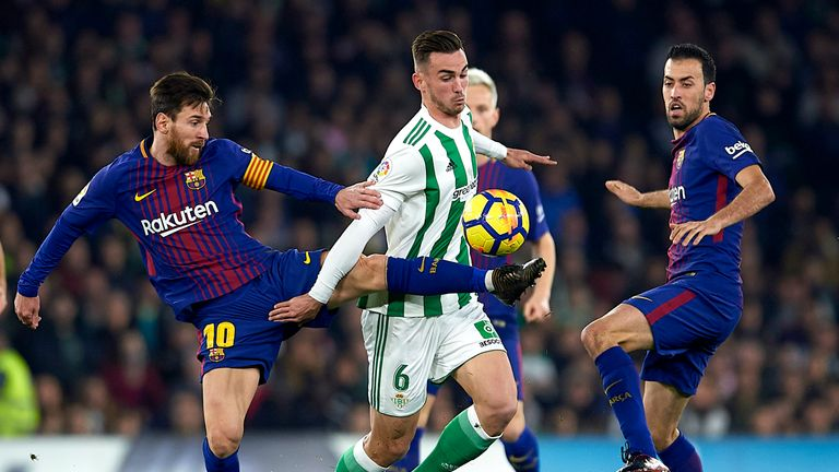 Lionel Messi (left) in action against Betis