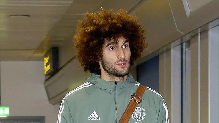 Marouane Fellaini at Manchester Airport ahead of a flight to Dubai for a warm-weather training camp