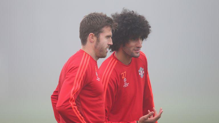 MANCHESTER, ENGLAND - NOVEMBER 02:  Marouane Fellaini and Michael Carrick of Manchester United talk during a Manchester United training session on the eve