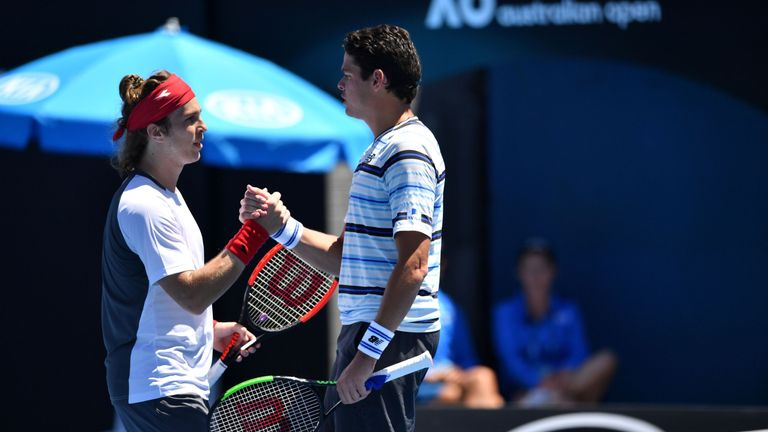 Lukas Lacko (L) ended Milos Raonic's hopes of a successful Aussie Open