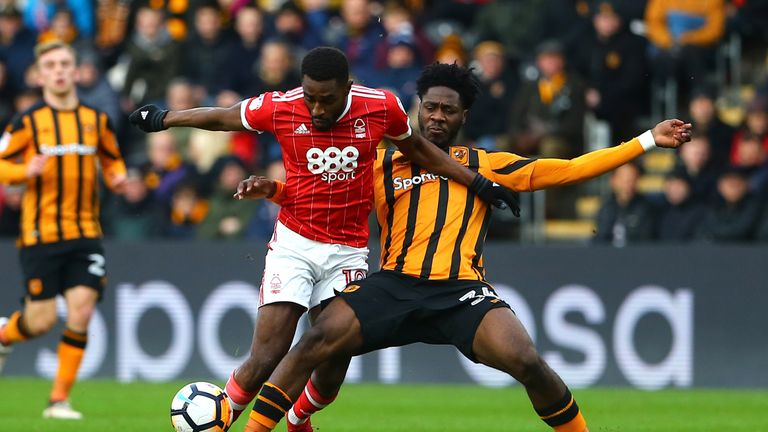 Nottingham Forest's Mustapha Carayol holds off Hull City's Ola Aina