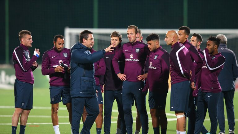 VILNIUS, LITHUANIA - OCTOBER 11:  Harry Kane and Jonjo Shelvey of England stand alongside team mates as they listen to Gary Neville during a training sessi