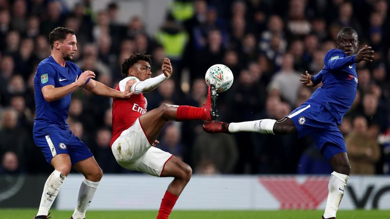 N'Golo Kante and Danny Drinkwater of Chelsea tackles Alex Iwobi of Arsenal during the Carabao Cup Semi-Final First Leg match