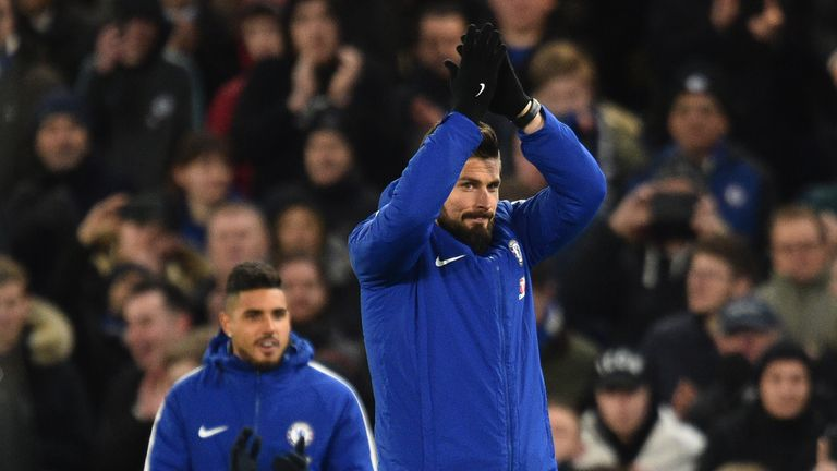 Olivier Giroud applauds the Chelsea fans after being unveiled at Stamford Bridge on Wednesday