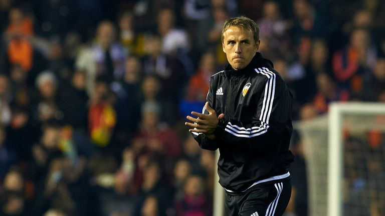 VALENCIA, SPAIN - DECEMBER 05:  Valencia CF assistant coach Phil Neville celebrates at the end of the La Liga match between Valencia CF and FC Barcelona at