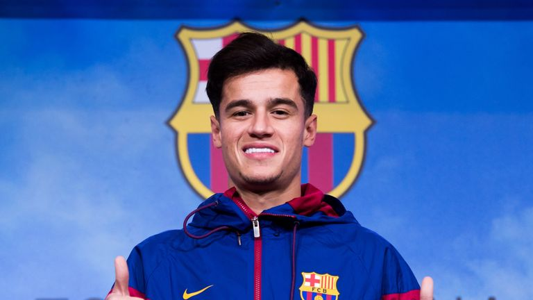 Philippe Coutinho poses prior to signing his new contract with Barcelona at Nou Camp Stadium on January 7, 2018