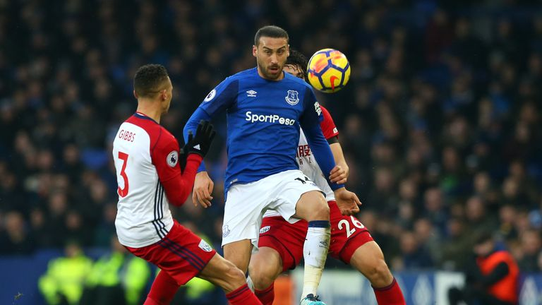 Cenk Tosun keeps his eye on the ball while under pressure from Kieran Gibbs